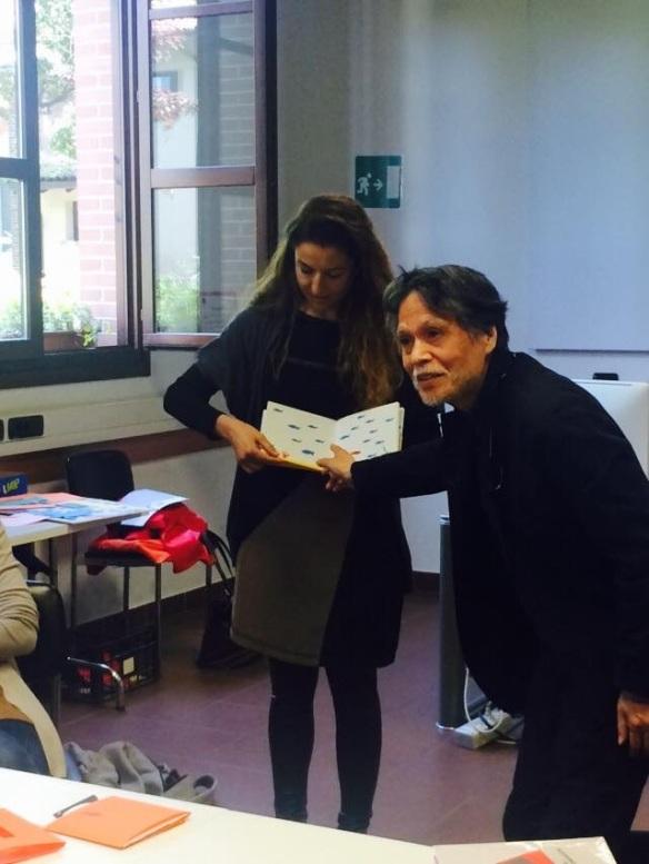 Me presenting my book to Katsumi Komagata